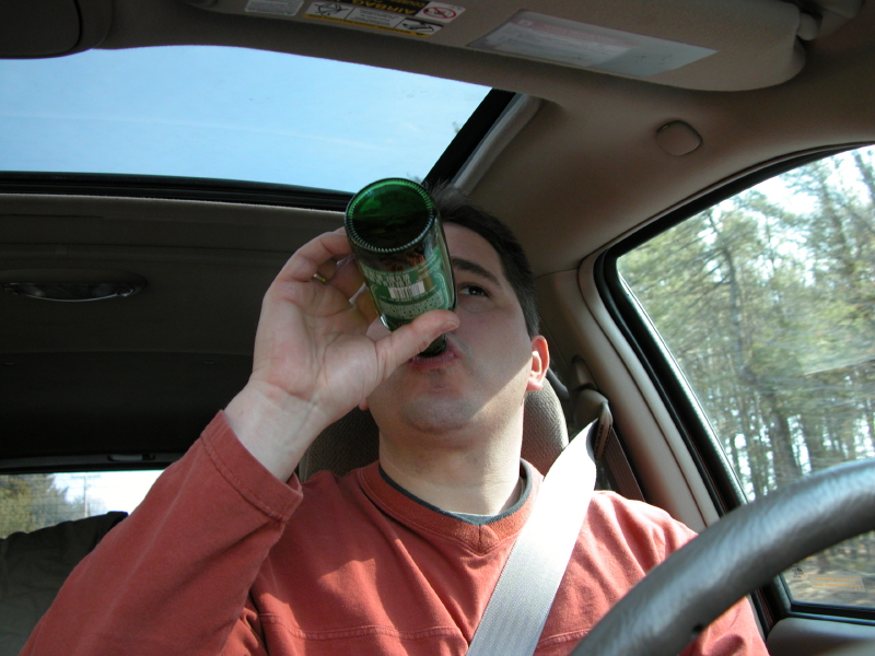 Man driving with an open container
