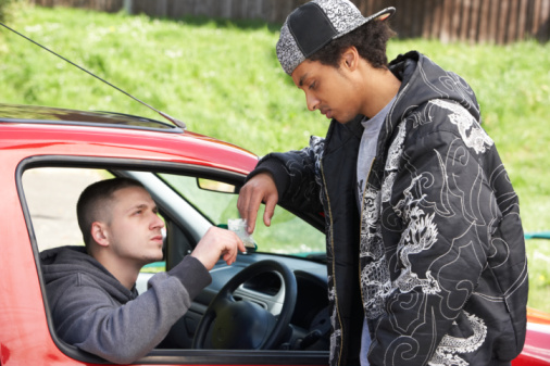 Young Man Dealing Drugs From Car